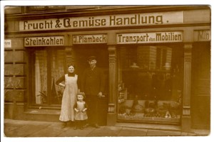 My grandfather with his mother and uncle in front of their store in Germany