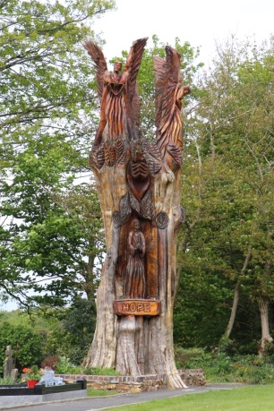 A tree got hit by lightning. So a man took his chainsaw and did this to it.