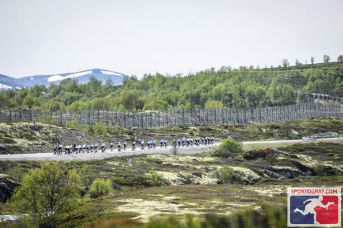 The peloton attacks the mountains.