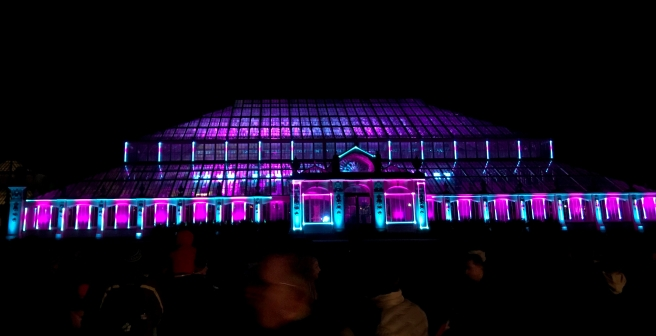 Laser light show projected onto the Glass House