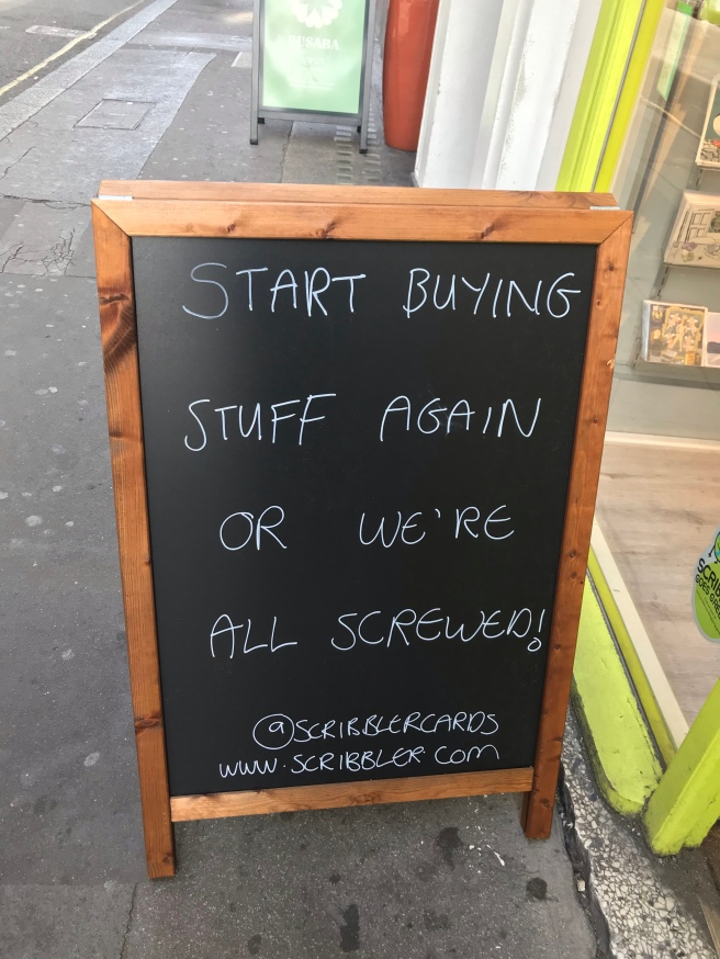 start buying stuff again or we're all screwed sign