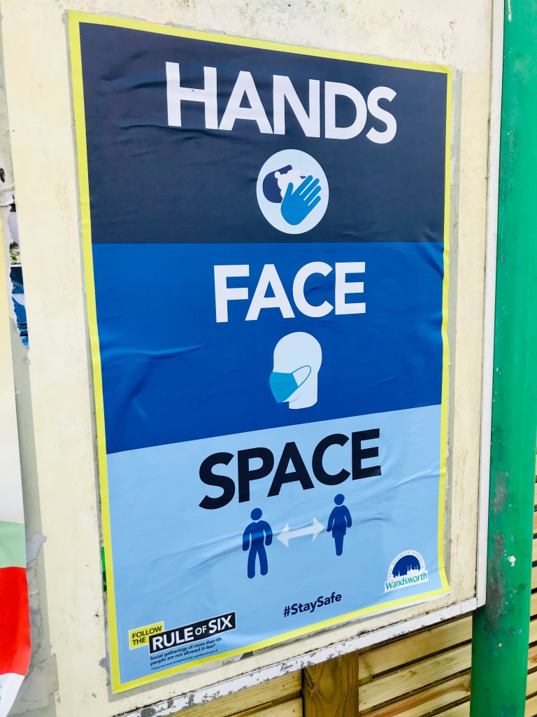 Hands face space sign